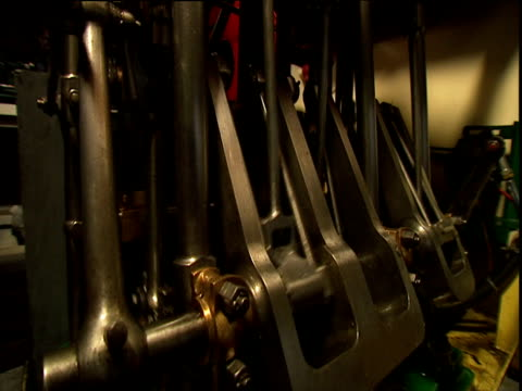 Oscillating pistons in engine room of steam boat
