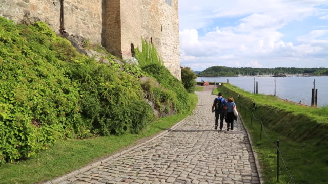 oslo, akershus fortress, tourists walking on the main road to the castle - fortress stock videos & royalty-free footage