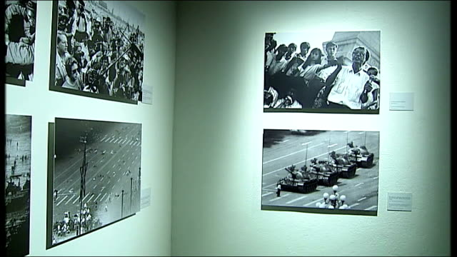 oslo int photographs of 1989 tiananmen square protests on art gallery wall - piazza tiananmen video stock e b–roll