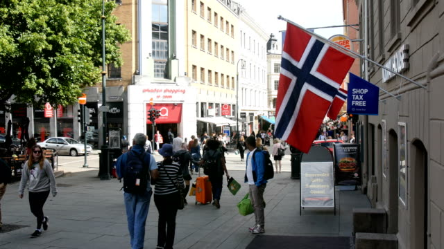 oslo/norway flag and pedestrians crowd in a busy street - norway stock videos & royalty-free footage