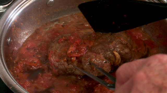 osso bucco cooking - italian culture stock videos & royalty-free footage
