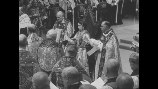 others putting robe on elizabeth / queen elizabeth ii, seated in king edward's chair, receives the sovereign's orb from the archbishop of canterbury... - newsreel stock videos & royalty-free footage