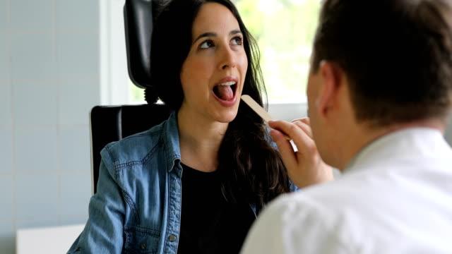 otolaryngologist checking woman's throat - examining stock videos & royalty-free footage