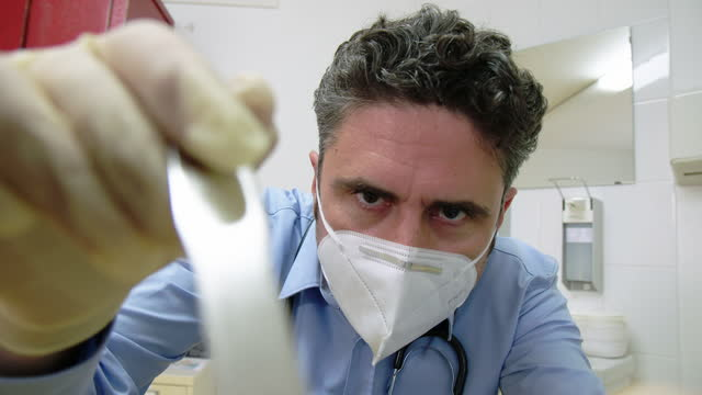 otolaryngologist examines sore throat of patient - lymph node stock videos & royalty-free footage