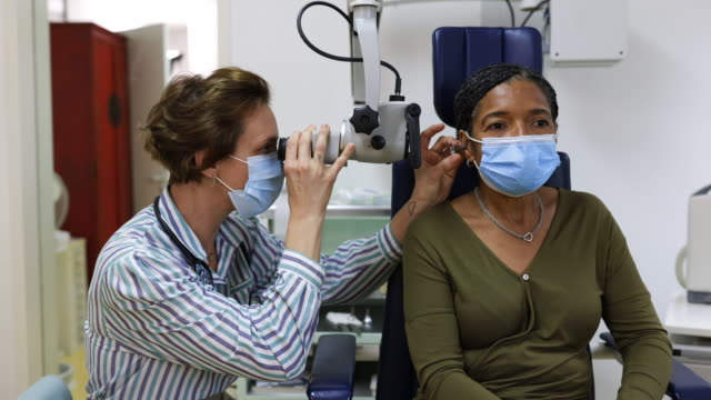 otolaryngologist examining senior woman patient - hearing loss stock videos & royalty-free footage