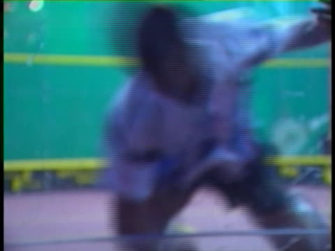 ouch! a squash player player is caught on camera smashing his head into the plexiglass wall! - blooper film clip stock videos & royalty-free footage