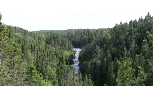 ouiatchouan waterfall, val-jalbert falls, lac st-jean, quebec, canada - falling water stock videos & royalty-free footage