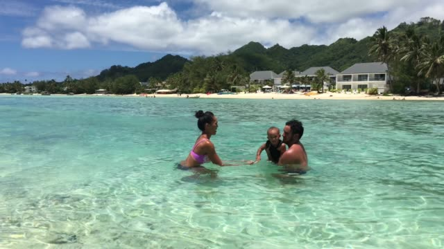 oung pacific islanders couple having fun with their baby - rarotonga stock videos & royalty-free footage