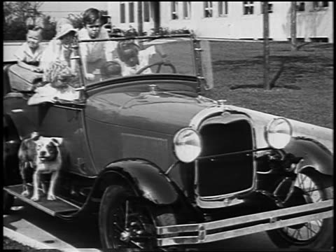 our gang cast sitting in convertible / black child at wheel / newsreel - dog convertible stock videos & royalty-free footage