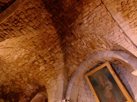 our lady of elige. tilt down from vaulted ceiling to altar. - apse stock videos & royalty-free footage