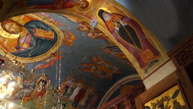our lady of hammatoura monastery. pan-left on a byzantine style fresco of christ pantocrator painted on the ceiling of a greek orthodox church in the... - heiliger stock-videos und b-roll-filmmaterial