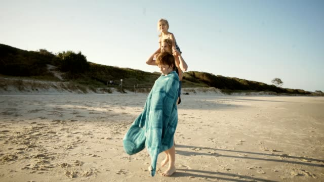 our vacations are made of sand, sea and fun in the sun. - single mother stock videos & royalty-free footage