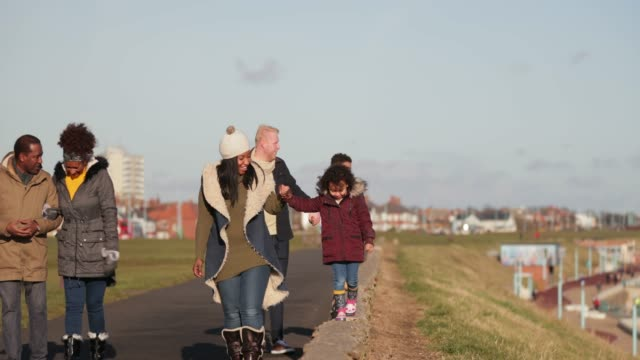 out for a walk in the winter - whitley bay stock videos & royalty-free footage