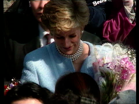Out of court settlement reached over Princess of Wales gym photos JAPAN Tokyo THROUGHOUT ** Princess of Wales towards with entourage Diana LR shaking...