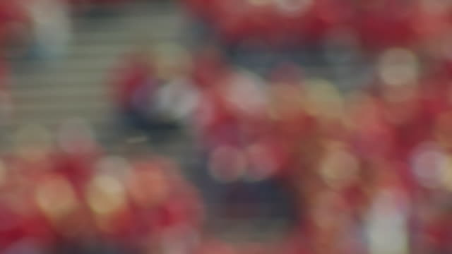 out of focus background shot of spectators in a football stadium, camera pans right. - nebraska stock videos & royalty-free footage