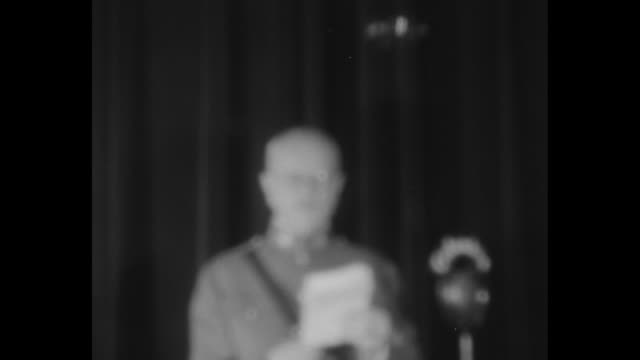 out of focus ms general john pershing us army stands before black curtain and reads statement blurry microphone stand also visible pershing wears... - john pershing stock videos & royalty-free footage