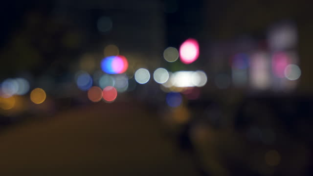 Out of focus night time city view.