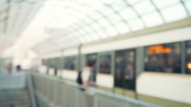 out of focus rail road station. - railway station platform stock videos and b-roll footage