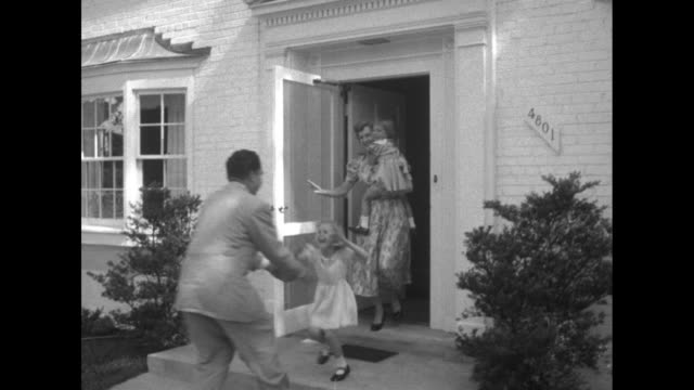 Out of focus CU Richard Nixon sitting on a couch with his wife and daughter Nixon arrives at home greeted by daughters Julie and Tricia wife Pat / VS...