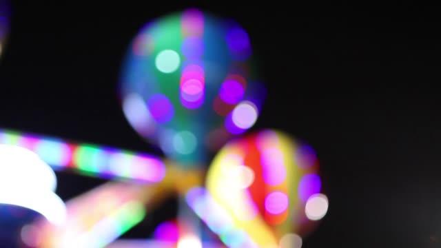 TIGHT SHOT - Out of focus ride at night at Coney Island, Brooklyn, NY USA