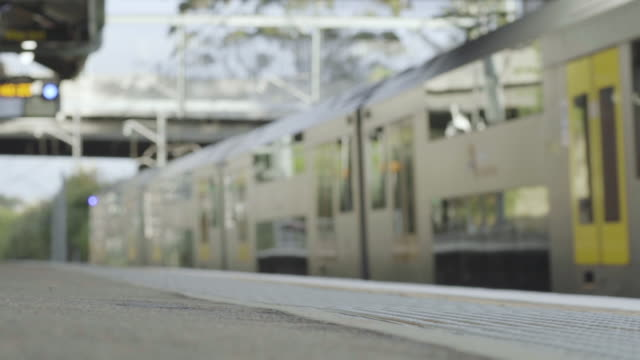 out of focus shot of train leaving station - station stock videos & royalty-free footage