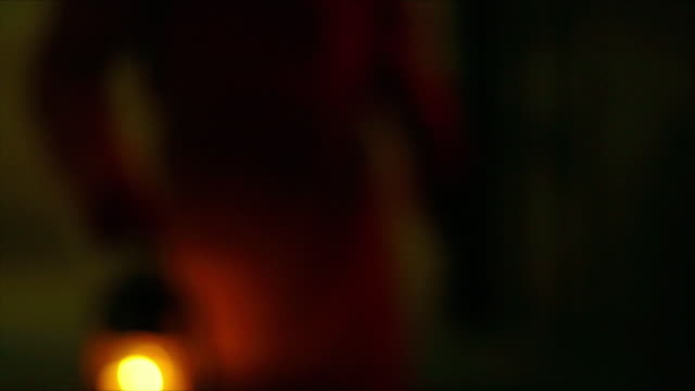 out of focus shots of a man carrying a lantern walking down a dark corridor - crime and murder stock videos & royalty-free footage