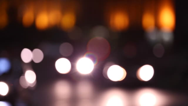 out of focus traffic lights in fullhd. - headlight stock videos & royalty-free footage