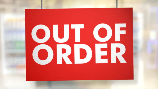 Out of order sign hanging from ropes. Luma matte included so you can put your own background.