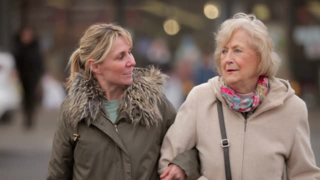 out shopping together - senior women stock videos & royalty-free footage