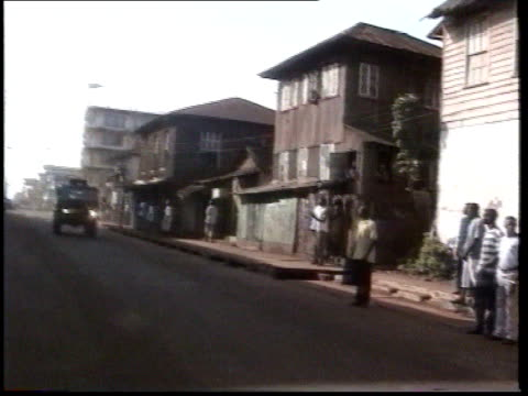 outbreaks of violence conflict/sierra leone outbreaks of violence itn sierra leone freetown gv army truck towards and past followed by red cross... - holprig stock-videos und b-roll-filmmaterial