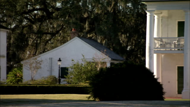 Outbuildings stand next to the Evergreen Plantation house. Available in HD.