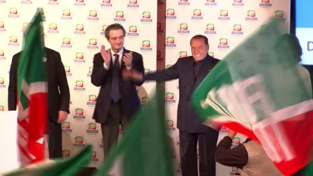 Outcome of General Election uncertain as final rallies take place ITALY Rome INT Silvio Berlusconi at election rally Crowd waving flags at rally