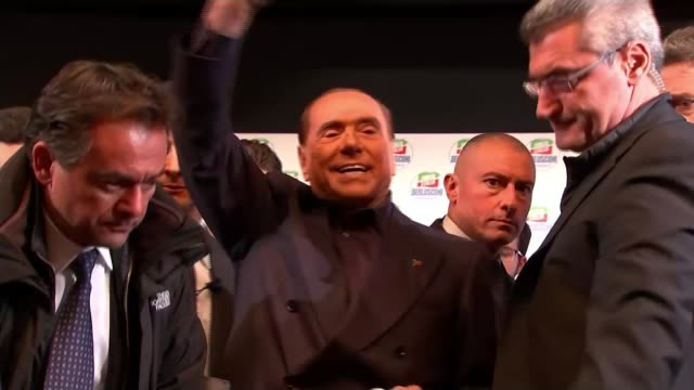 Outcome of General Election uncertain as final rallies take place ITALY Rome INT Silvio Berlusconi addressing rally People in crowd applauding Silvio...