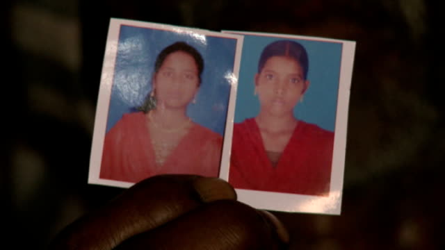 outcry after rape and murder of teenage girls india uttar pradesh katra sadatgunj int close shot of two photographs held in hand showing two teenage... - uttar pradesh stock videos and b-roll footage
