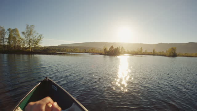 outdoor adventures: pov canoeing in a lake at sunset - small boat stock videos & royalty-free footage