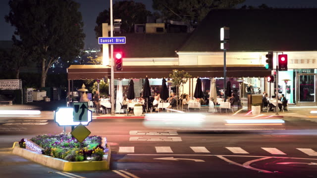 WS T/L Outdoor café restaurant in Sunset Plaza district of the Sunset Strip at night / West Hollywood, California, USA