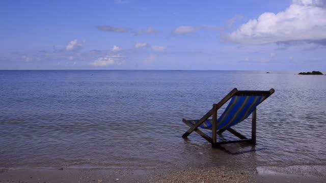 outdoor chair at tropical beach - armchair stock videos & royalty-free footage