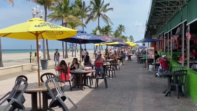 outdoor dining in front of closed hollywood beach in florida for 4th of july. - hollywood florida stock videos & royalty-free footage