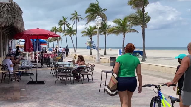 outdoor dining in front of closed hollywood beach in florida for 4th of july. - july stock videos & royalty-free footage