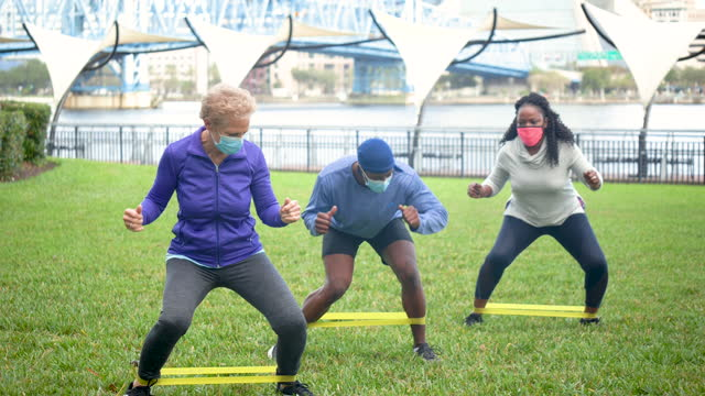 outdoor exercise class during covid-19 - trade union stock videos & royalty-free footage