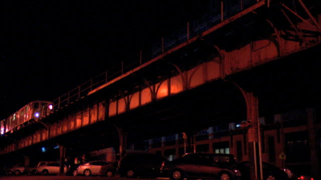 outdoor mta subway line in brooklyn with 2 seventh avenue express train passing , parked cars lower frame under subway line. nyc - brooklyn new york stock videos & royalty-free footage