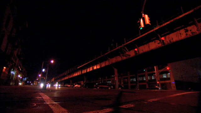 outdoor nyc metropolitan transportation authority, mta subway line in brooklyn , some cars driving toward frame from bg to fg . nyc - brooklyn new york stock videos & royalty-free footage