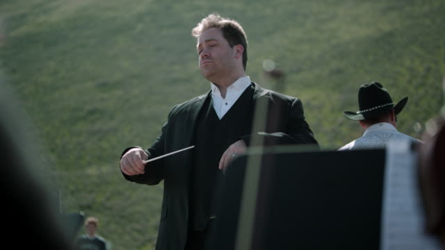 outdoor orchestra - conductor - musical conductor stock videos & royalty-free footage