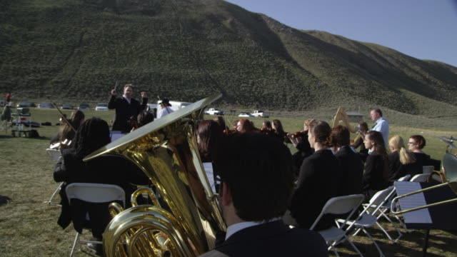outdoor orchestra - musical conductor stock videos & royalty-free footage