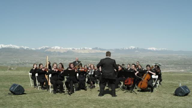 outdoor orchestra - orkester bildbanksvideor och videomaterial från bakom kulisserna