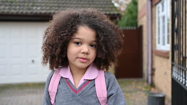 outdoor portrait of 5 year old mixed race schoolgirl - mixed race person stock videos & royalty-free footage