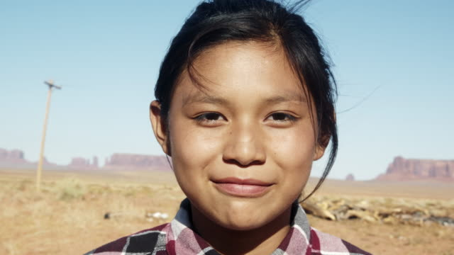 outdoor portrait of a beautiful navajo native american indian girl in the northern arizona desert on the monument valley indian reservation - indigenous north american culture stock videos & royalty-free footage