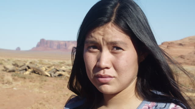 outdoor portrait of a beautiful navajo native american indian girl in the northern arizona desert on the monument valley indian reservation - one teenage girl only stock videos & royalty-free footage