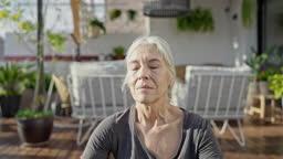 Outdoor Portrait of Meditative Senior Woman