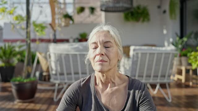 outdoor portrait of meditative senior woman - eyes closed stock videos & royalty-free footage